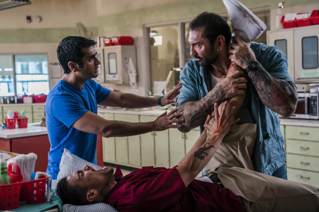 "Kumail Nanjiani as Stu, Dave Bautista as Vic, and Rene Moran as Amo in ""Stuber."" Photo Credit: Hopper Stone/SMPSP; © 2019 Twentieth Century Fox Film Corporation."